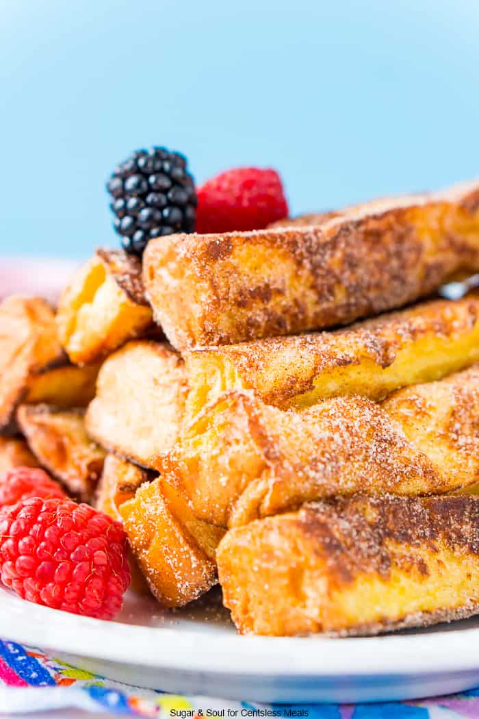 French toast sticks on a plate with berries