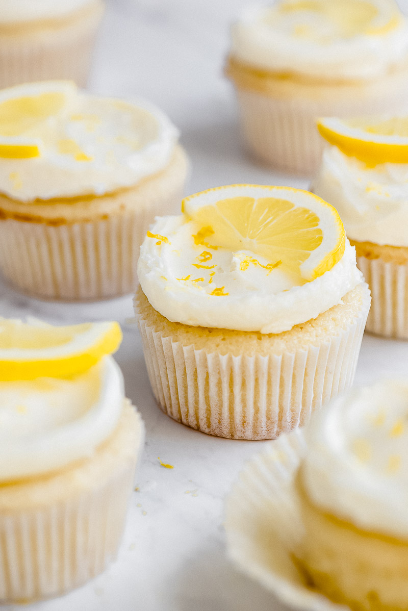 Lemon cupcakes with icing and lemon slices