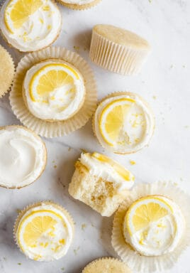 Lemon cupcakes on a marble board, some have icing