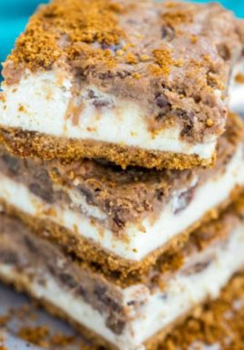 Pecan pie cheesecake bars on a plate with a title