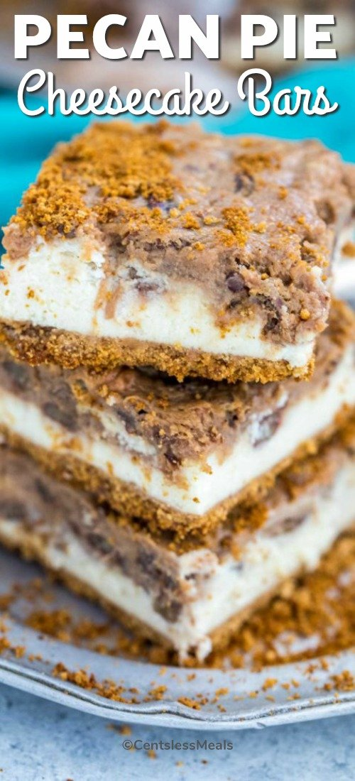 Pecan Pie Cheesecake Bars stacked up on a silver plate