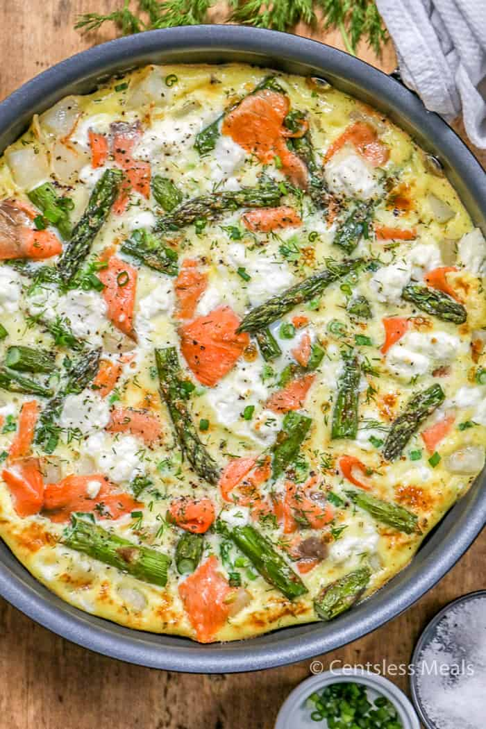 Simply Potatoes salmon frittata in a pan with parsley