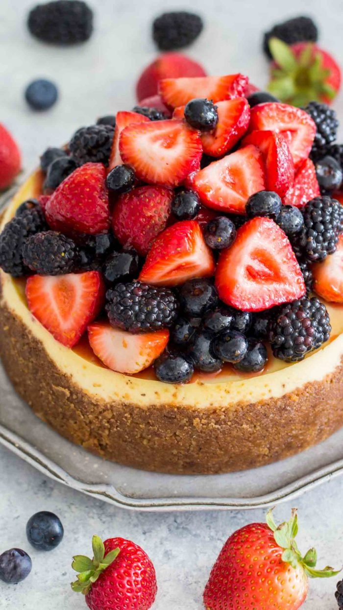 Instant pot cheesecake on a plate with berries
