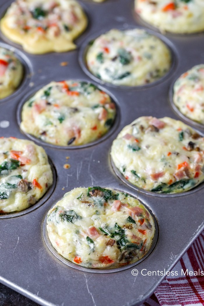 A muffin tin with baked egg muffins.