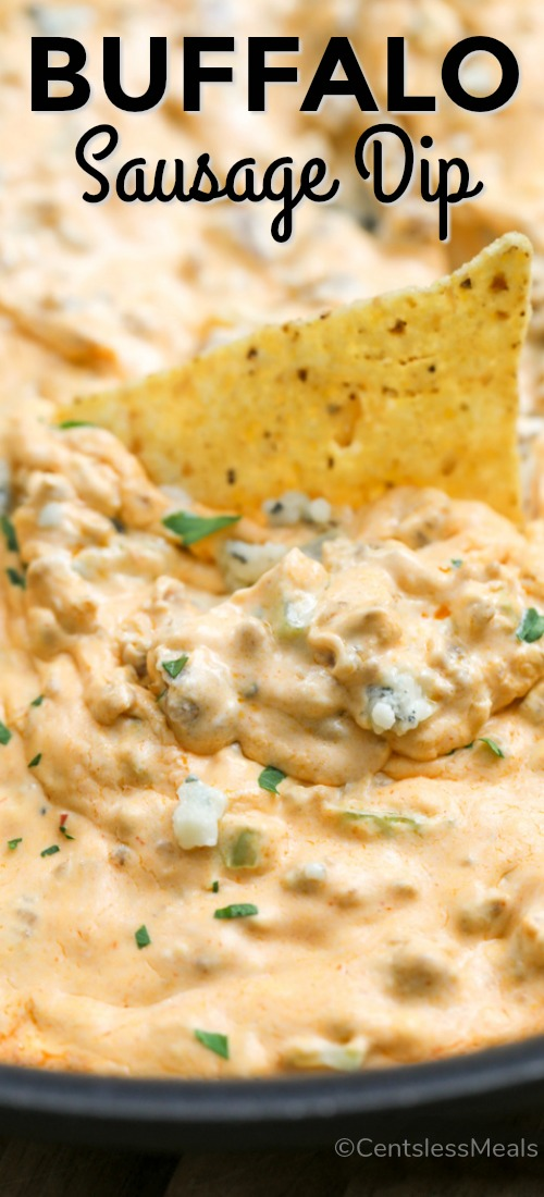 Buffalo Dip being scooped up with a tortilla chip