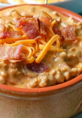 Bacon cheeseburger dip in a bowl with a title