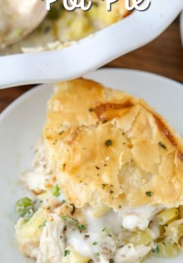 Chicken pot pie on a white plate with writing