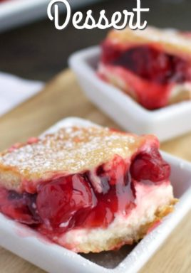 Cherry cream cheese dessert in bowls with a title