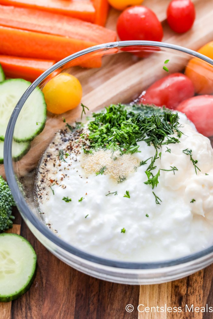 Ingredients for easy veggie dip in a clear Bowl