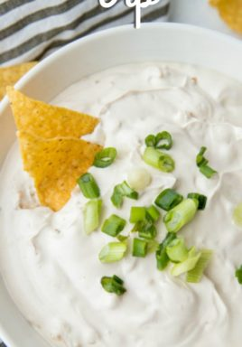 Onion dip in a bowl with green onions and a title