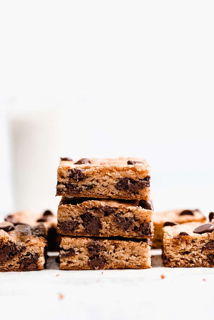 Three Cookie Bars stacked on each other showing the chocolate chip filled interior.