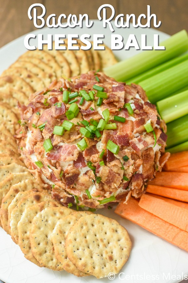overhead of Bacon Ranch Cheeseball on a plate with crackers, celery and carrots