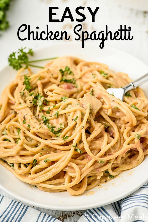 Chicken spaghetti on a plate with a fork and a title