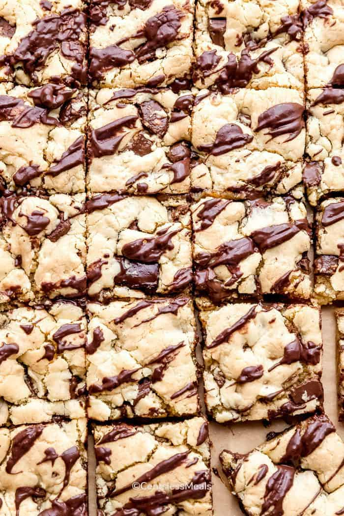 Squares of cake mix cookie bars on parchment paper