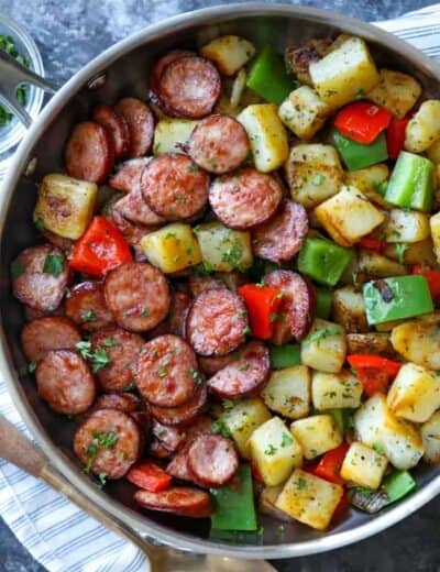 Sausage and potato Skillet in a pot with a spoon
