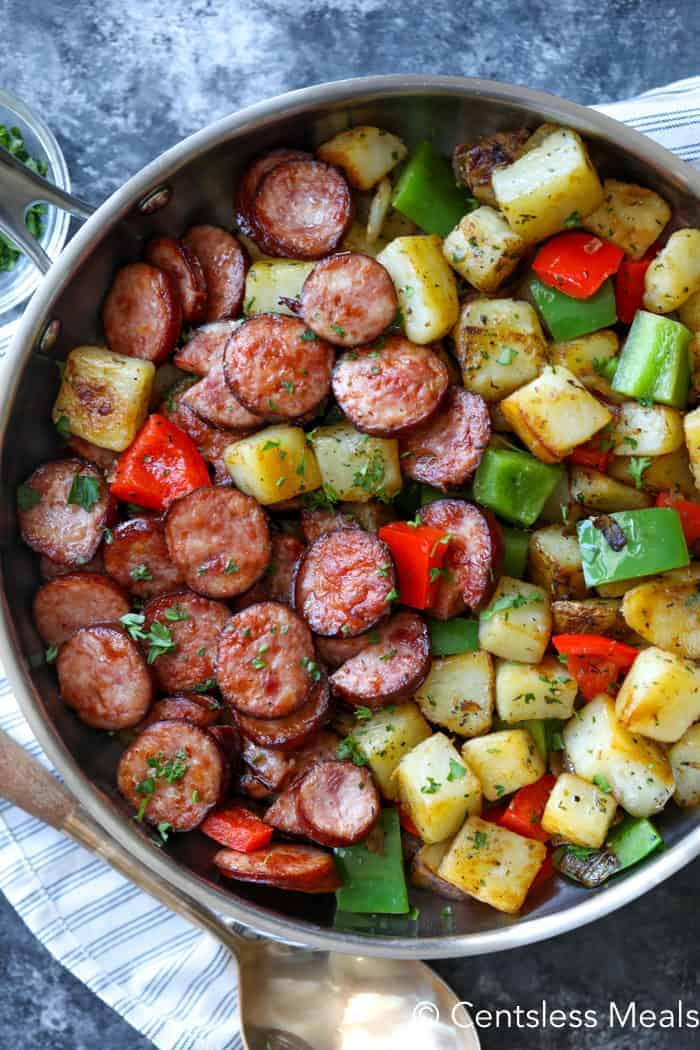 Potatoes, sausages, peppers and onions cooked in a skillet