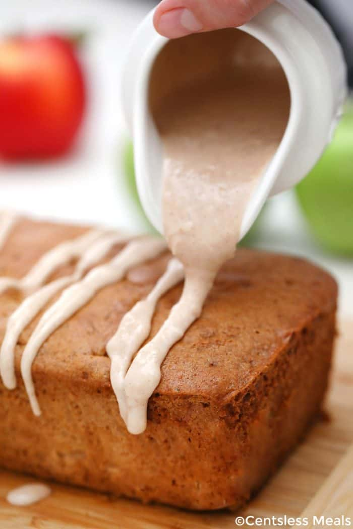 Cinnamon Apple Bread with sauce being poured on