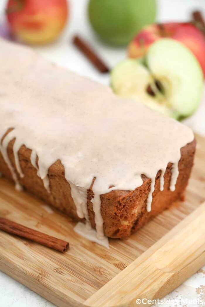 Cinnamon Apple Bread with icing on a wooden board