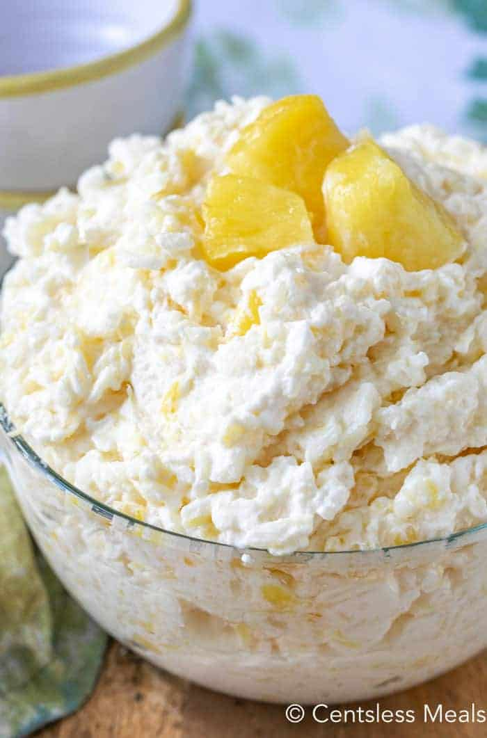 Pineapple Rice Pudding served in a clear bowl and garnished with pineapple chunks