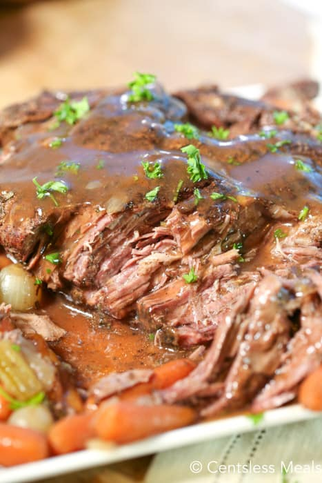 Slow cooker pot roast topped with gravy.