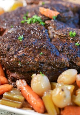 Slow cooker pot roast on a plate with a title