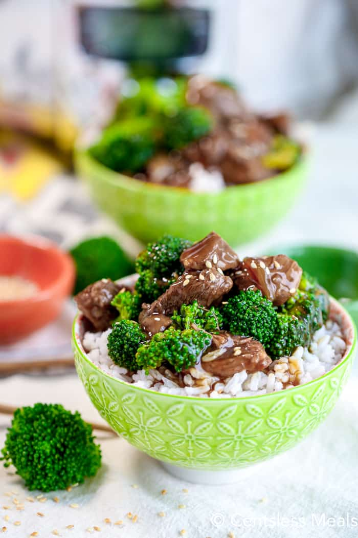 Beef and Broccoli served over rice in a green bowl