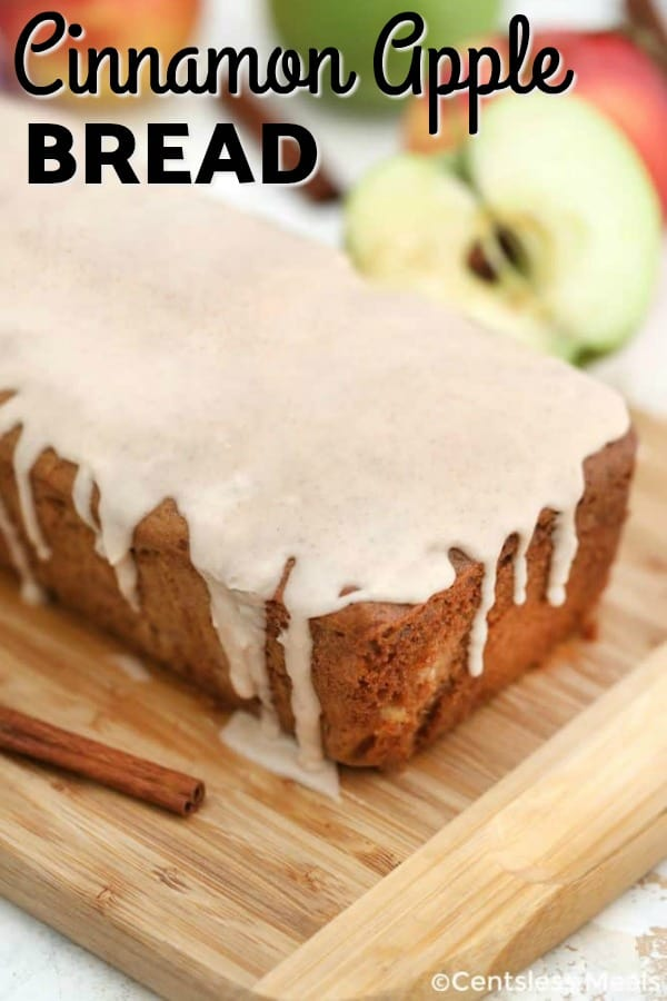 Cinnamon apple bread on a wooden board with writing
