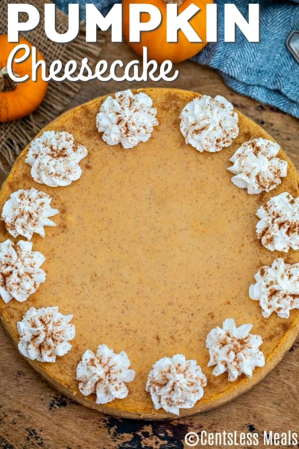 Pumpkin cheesecake on a wooden board with writing