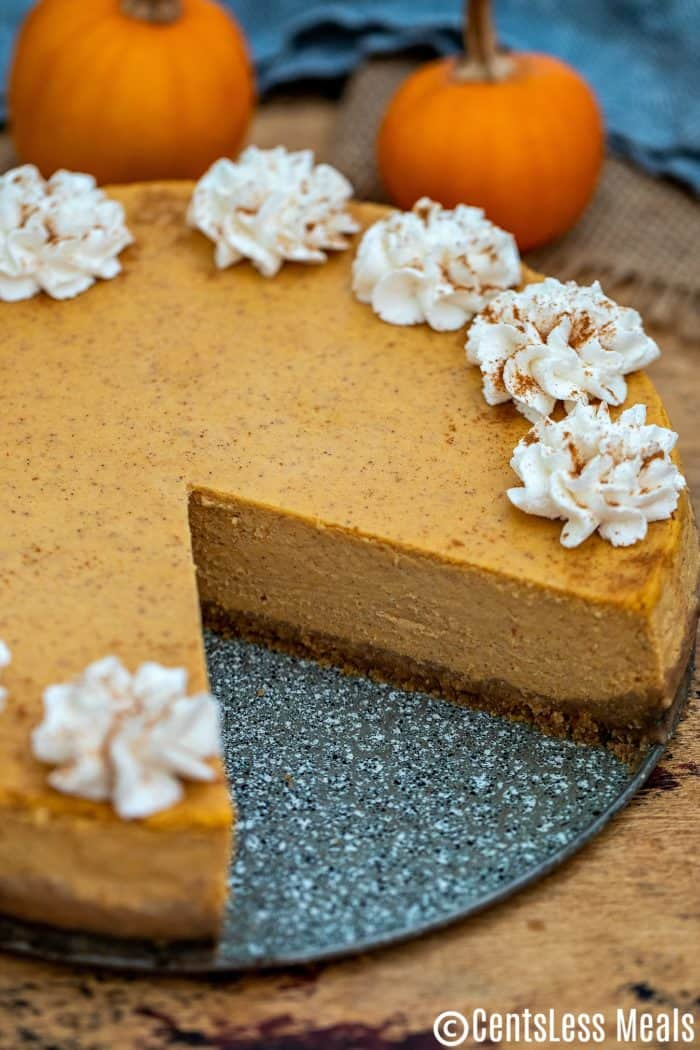 A slice has been removed from this pumpkin cheesecake.