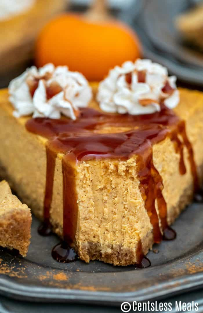 Pumpkin cheesecake on a plate with a bite taken out