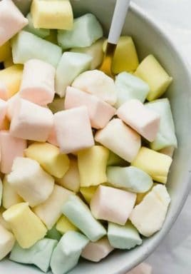 Butter mints in a bowl with a spoon and a title