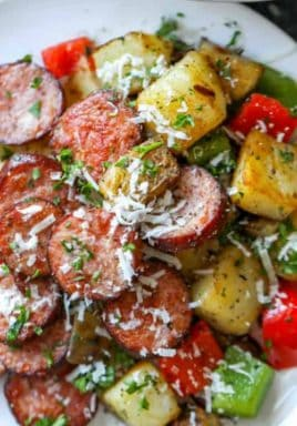 Sausage and potato Skillet on a white plate with text