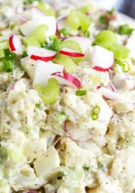 Creamy potato salad in a bowl with a title