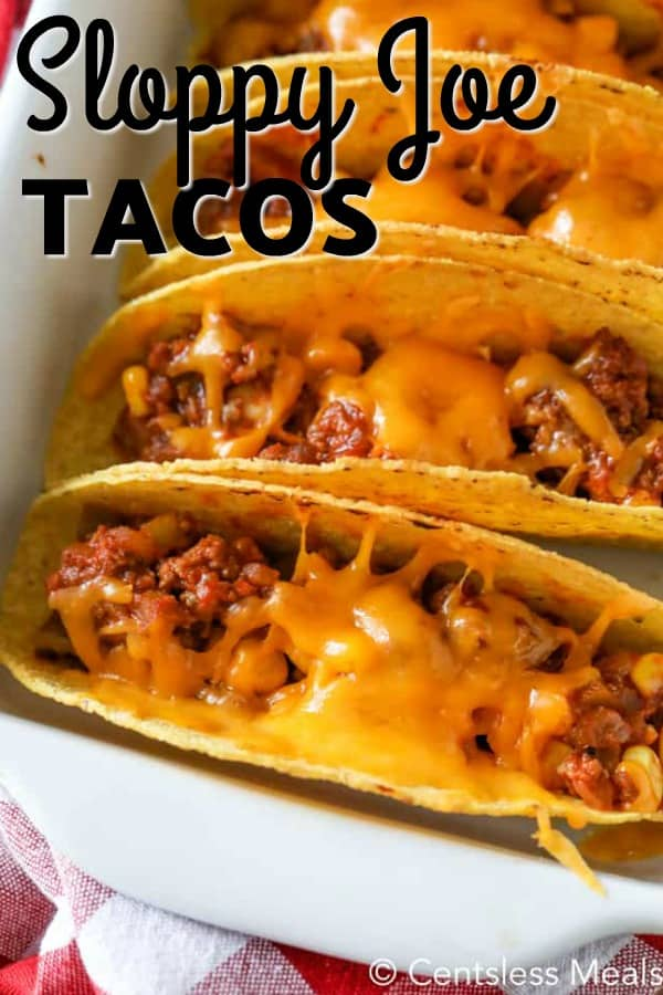 Sloppy Joe Tacos lined up in a white baking dish, with cheese melted on the top.