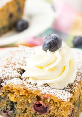 Breakfast blueberry cake on a plate with a title