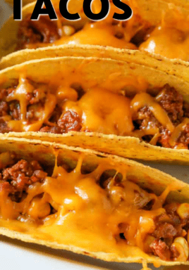 Sloppy joe tacos in a dish with writing