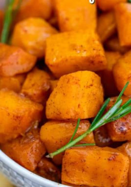 Roasted butternut squash in a bowl with rosemary and a title
