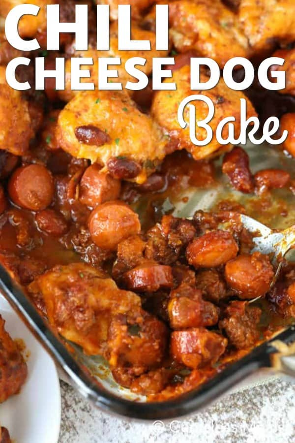 Chili cheese dog bake in a casserole dish with a spoon and a title