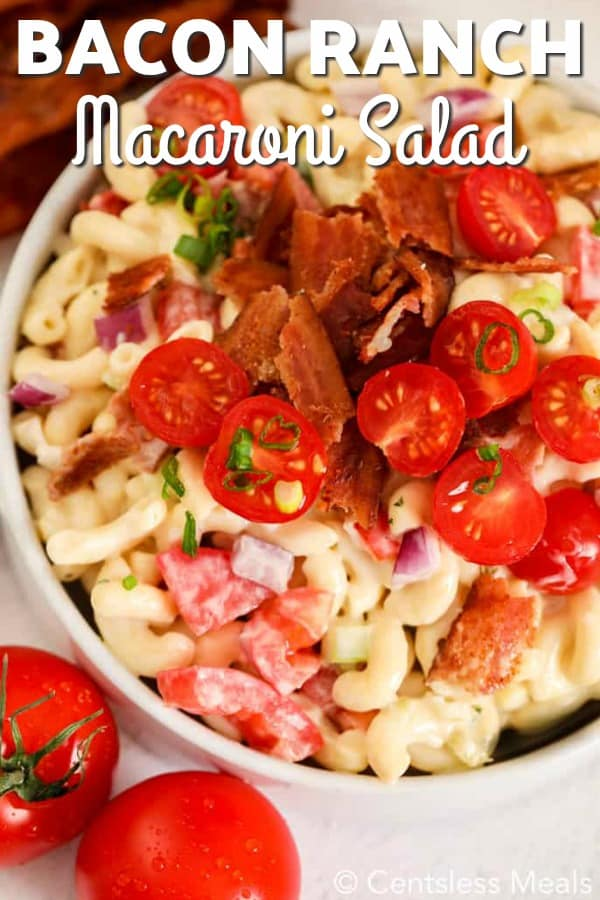 A top view of ranch macaroni salad with bacon and tomatoes.