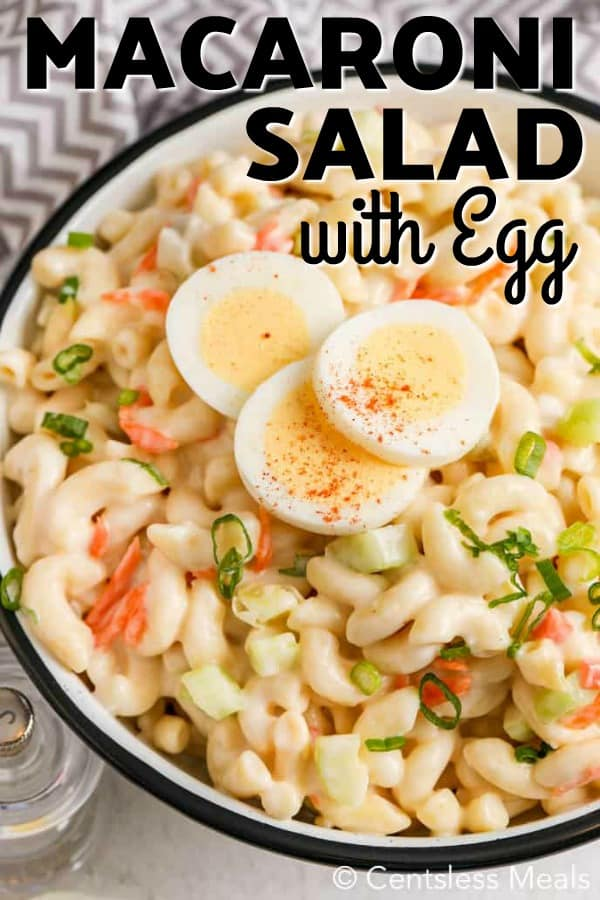 A large bowl of macaroni salad with egg.