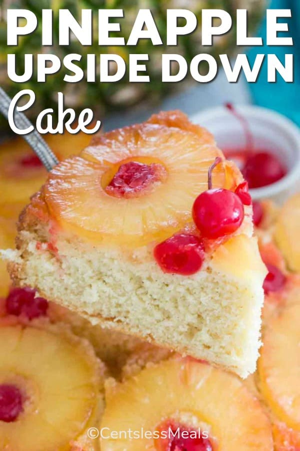 Slice of pineapple upside down cake with cherries and pineapple on top with writing
