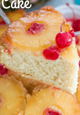 Pineapple upside down cake on a spatula with writing