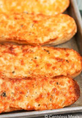Cheesy bread on a baking sheet