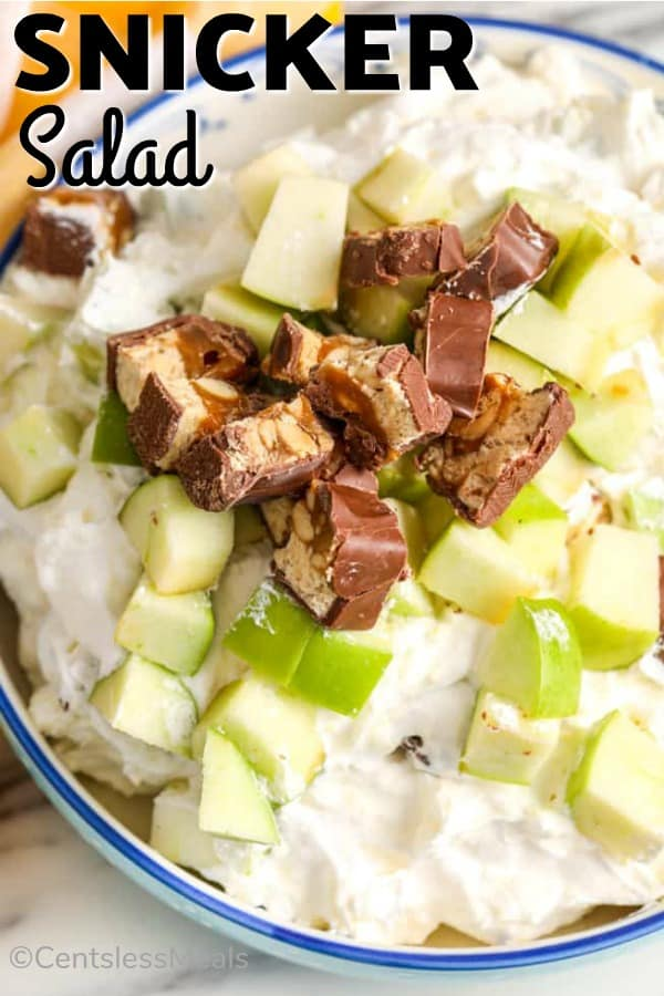Snicker salad in a bowl with a title