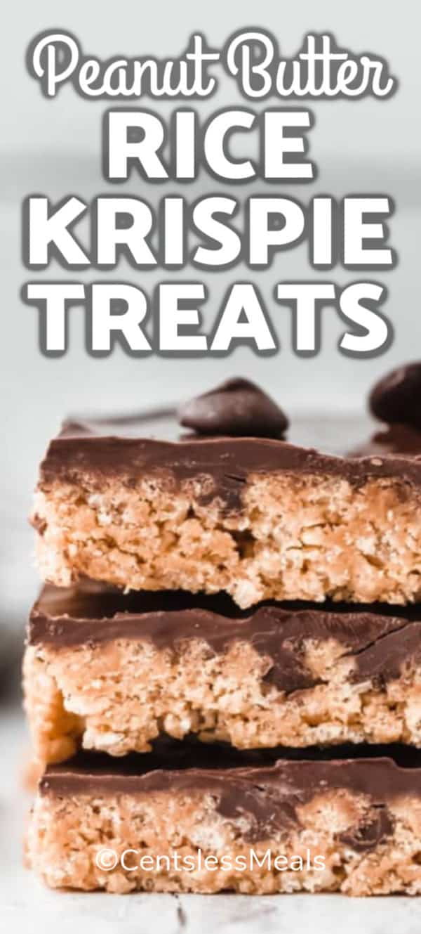 Three Rice Krispie Treats with peanut butter and covered with chocolate, stacked up together.