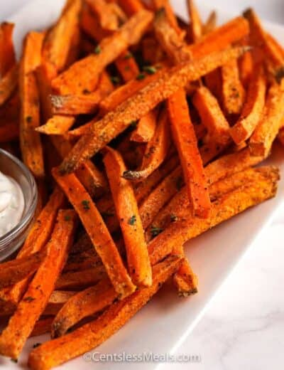 Sweet potato fries on a plate with aioli