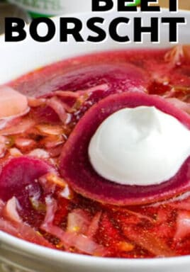 Beet Borscht served in a white bowl with a dollop of sour cream on the top with a title