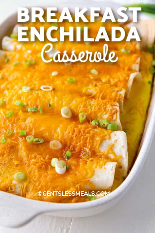 Breakfast Enchiladas baked in a white casserole dish with a title.