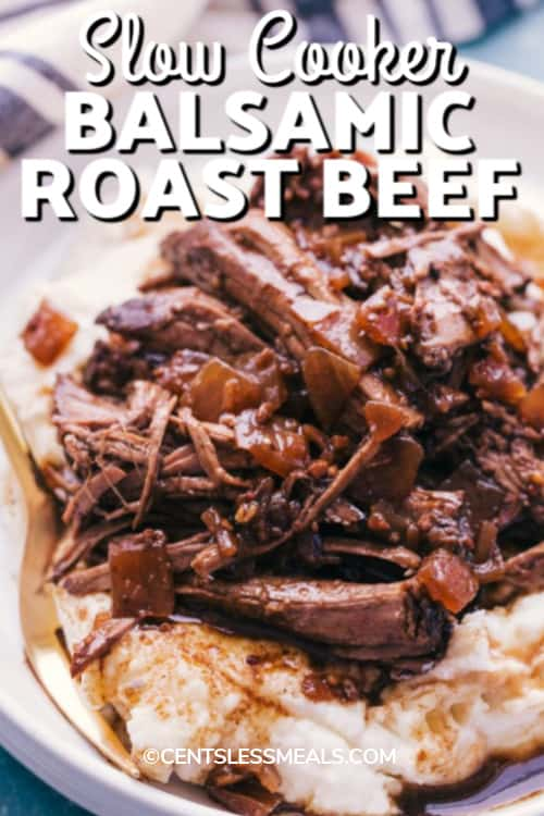 Slow Cooker Balsamic Roast Beef served over mashed potatoes with a title.