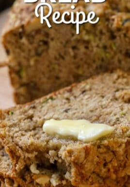 Zucchini Bread sliced with butter melting on the top, with a title.